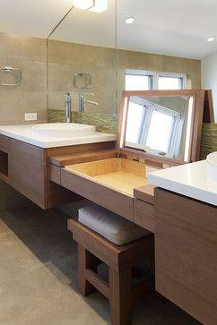 hidden makeup desk between the double sink, has outlet and lit ...