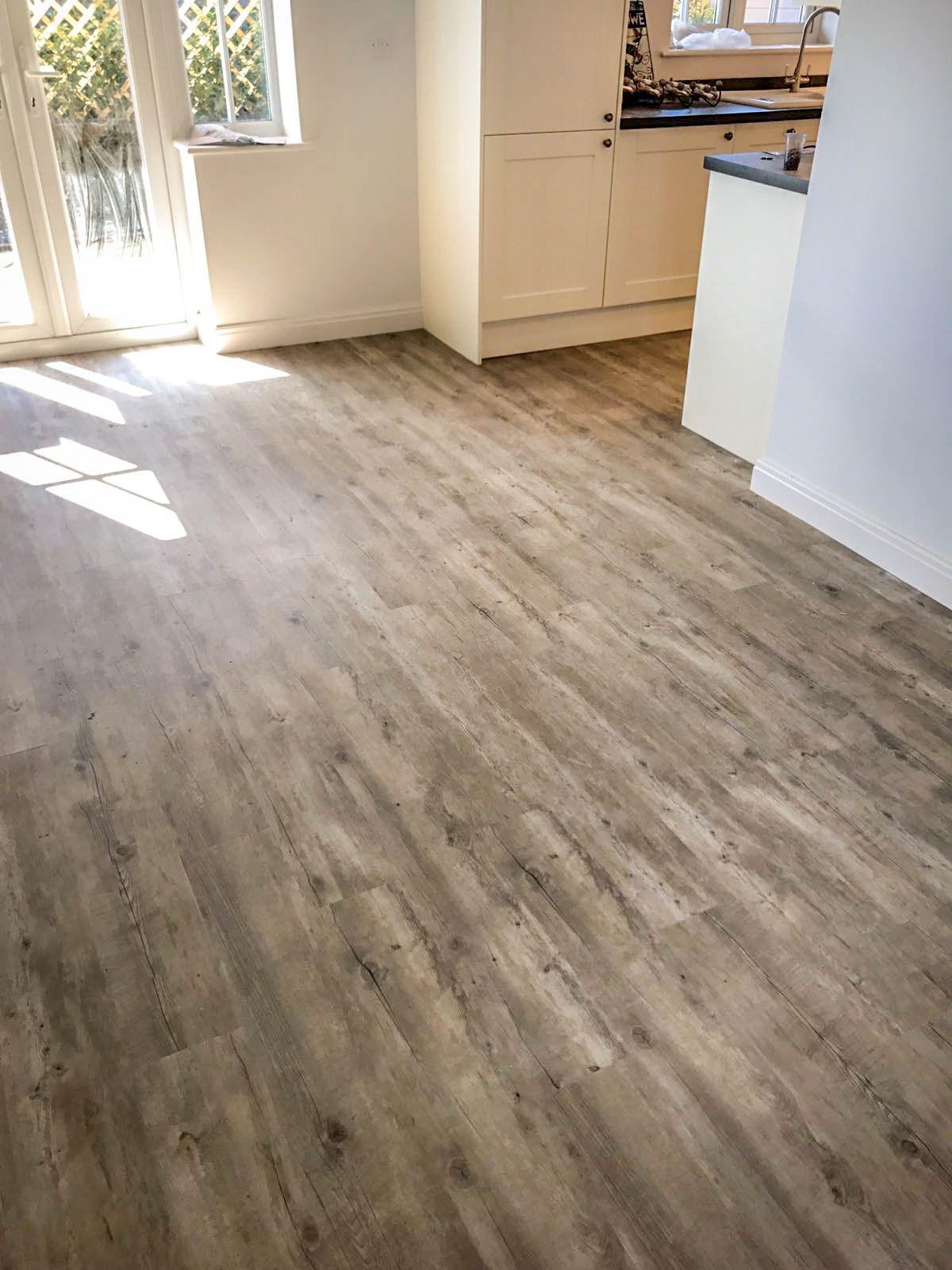 Living Room and Kitchen using Karndean wood flooring Van