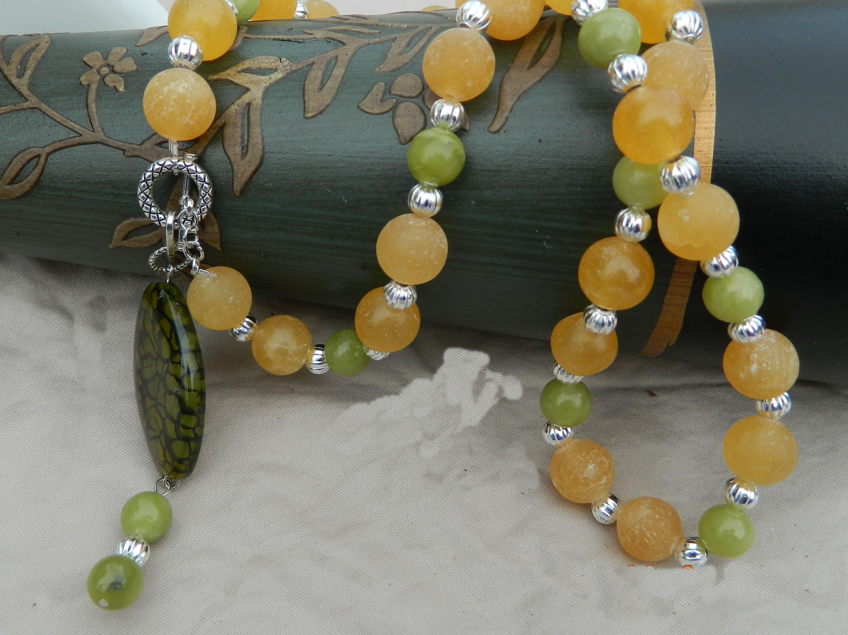 """Green & yellow jade necklace, Yellow & lemon jade chunky stones Tibet silver spacer beds. with dragon vein agate focal & front toggle. chunky beads make this a real eye catcher.... BE NOTICED!!!!......    Measures...23"""" from end to end & pendant hangs 3"""" from toggle clasp.. So total length would be 26 ''    Also have earrings to match SOLD SEPARATE..."""