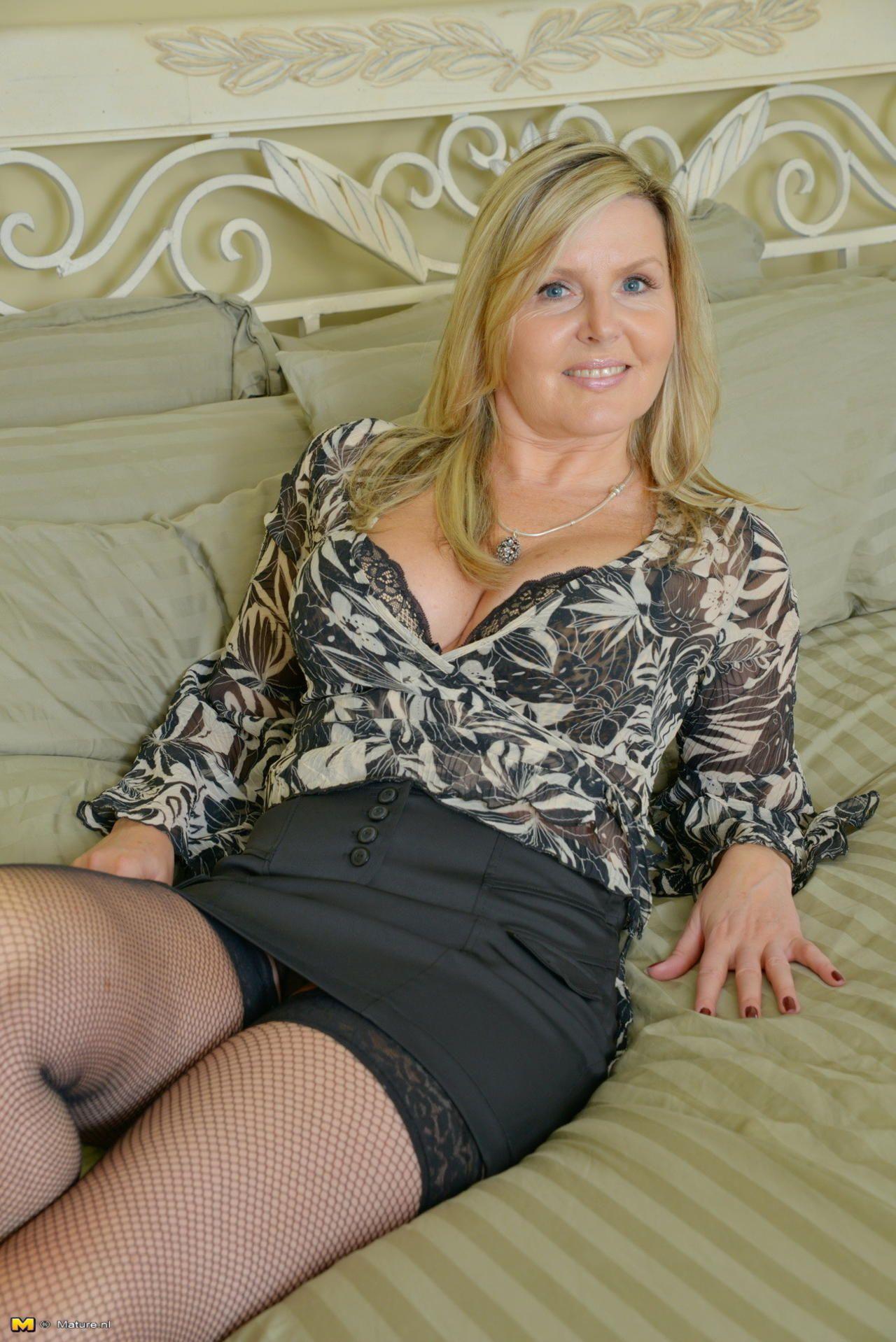 Mature In Mini Skirt