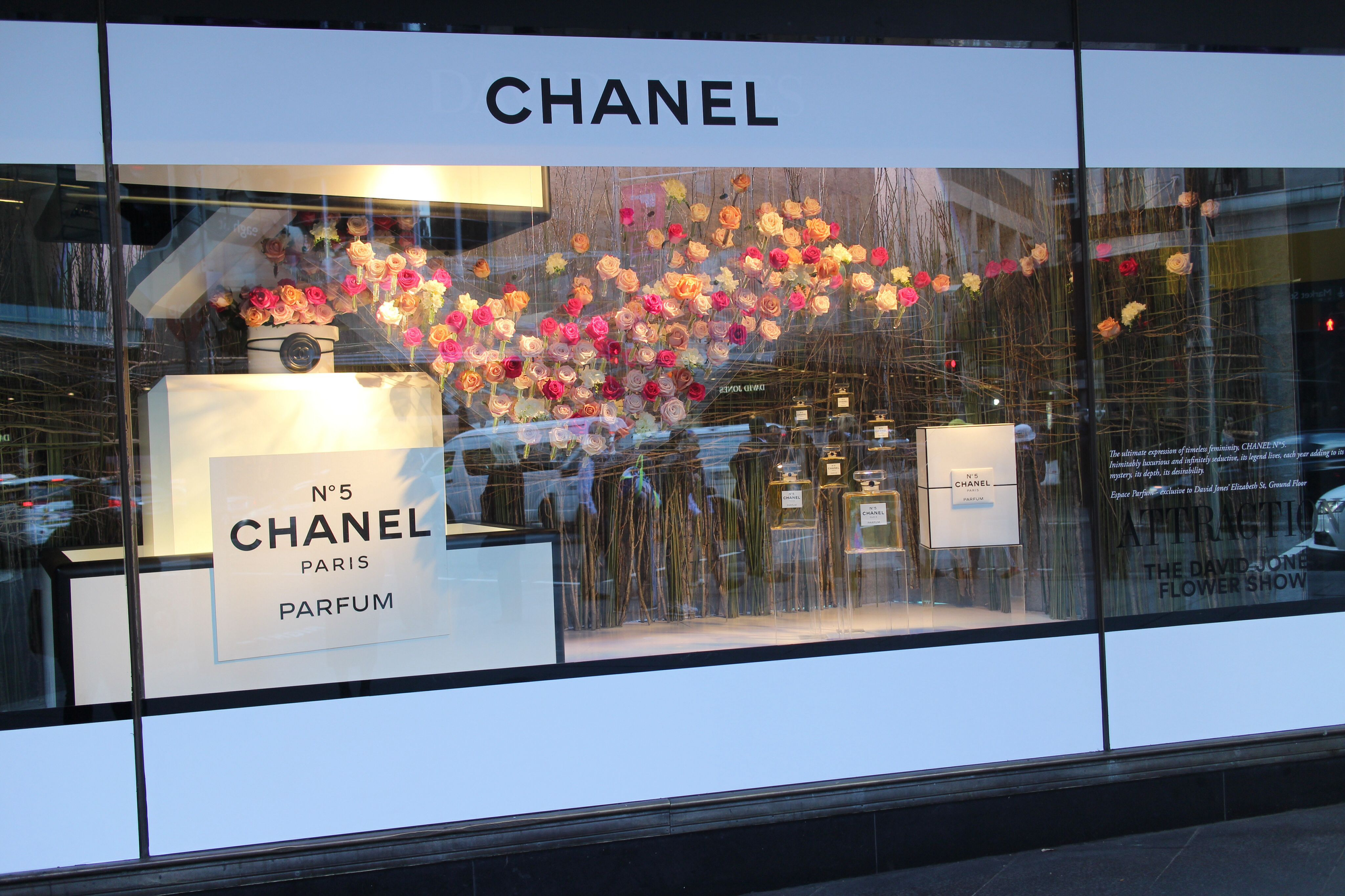 Beautiful chanel window display with blooms