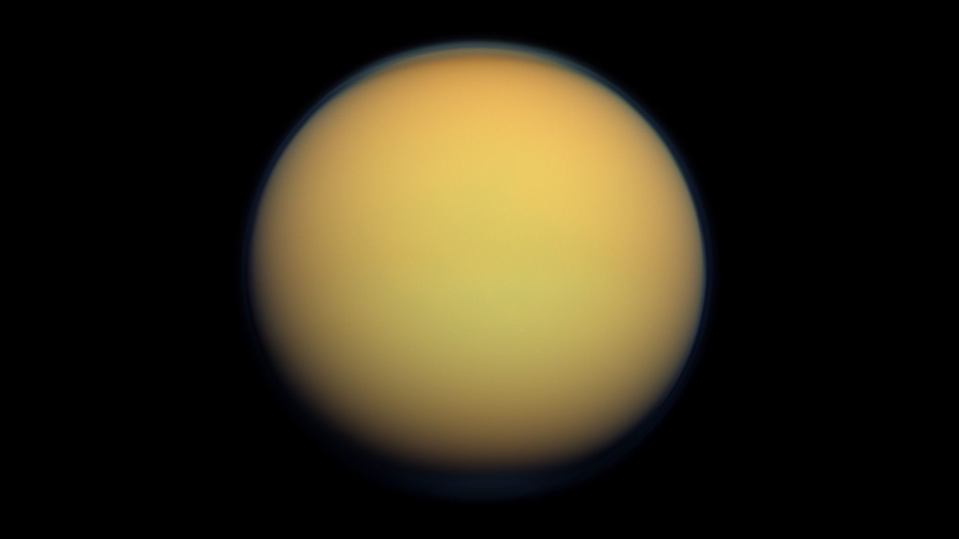 Titan (Saturn)  Titan is the largest moon of Saturn. It is the only moon known to have a dense atmosphere, and the only object in space other than Earth where clear evidence of stable bodies of surface liquid has been found. Titan is the sixth gravitationally rounded moon from Saturn. Frequently described as a planet-like moon