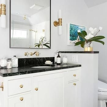 Photo of Black and white bathroom with pony wall