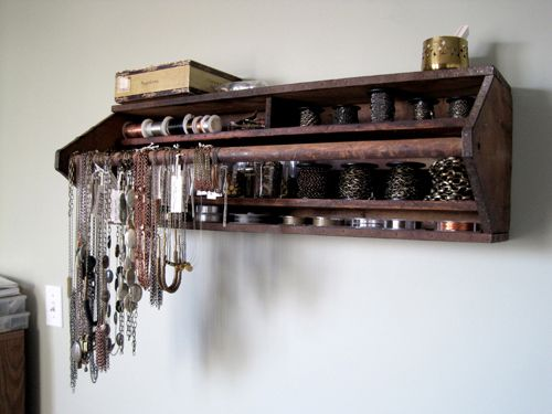 It's an old wooden toolbox turned on its side to become a jewelry organizer