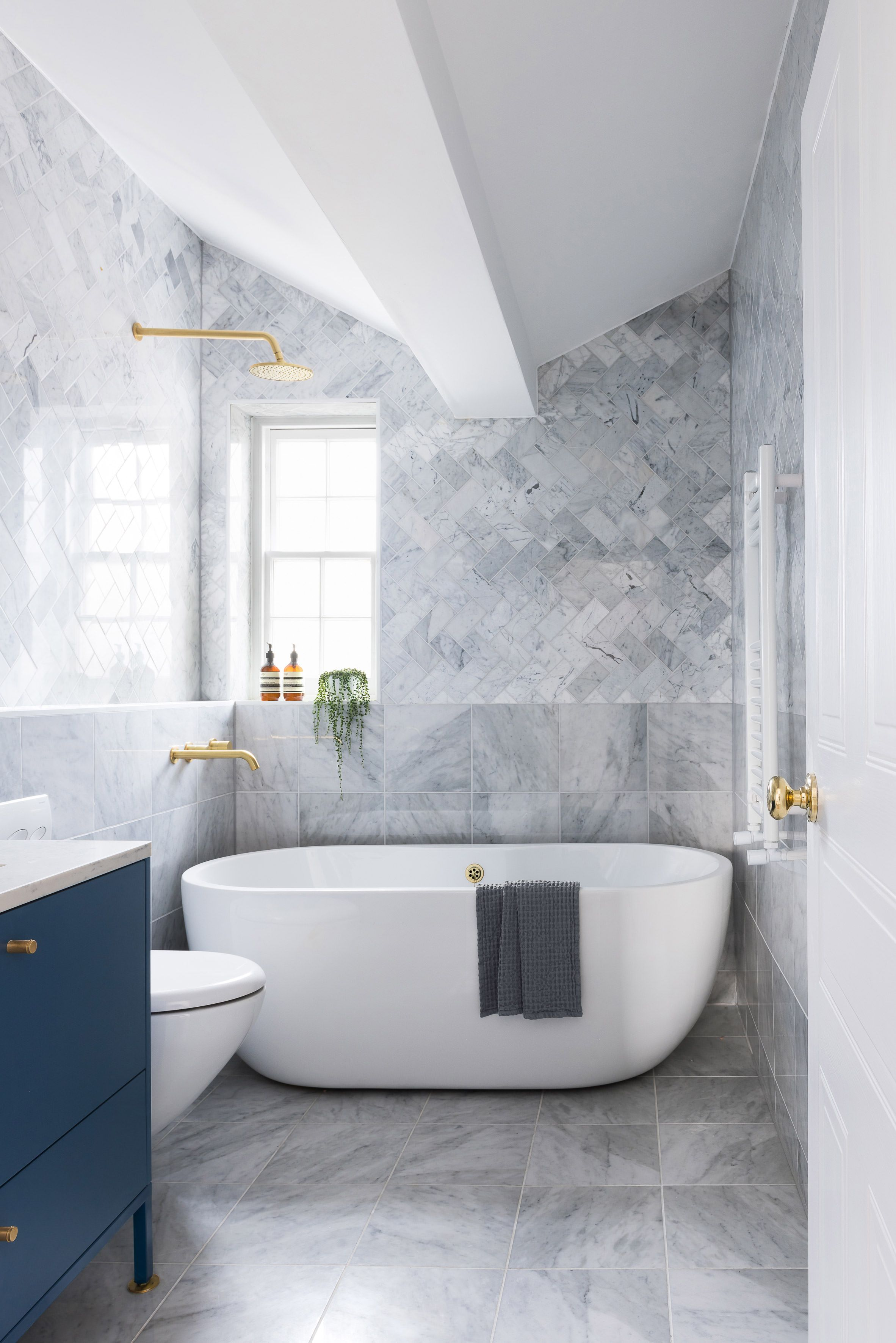 Bathroom With Herringbone Patterned Marble Tiles And Brass Tapware In A Renovated Townh Bathroom Design Inspiration Modern Bathroom Tile Modern Bathroom Design