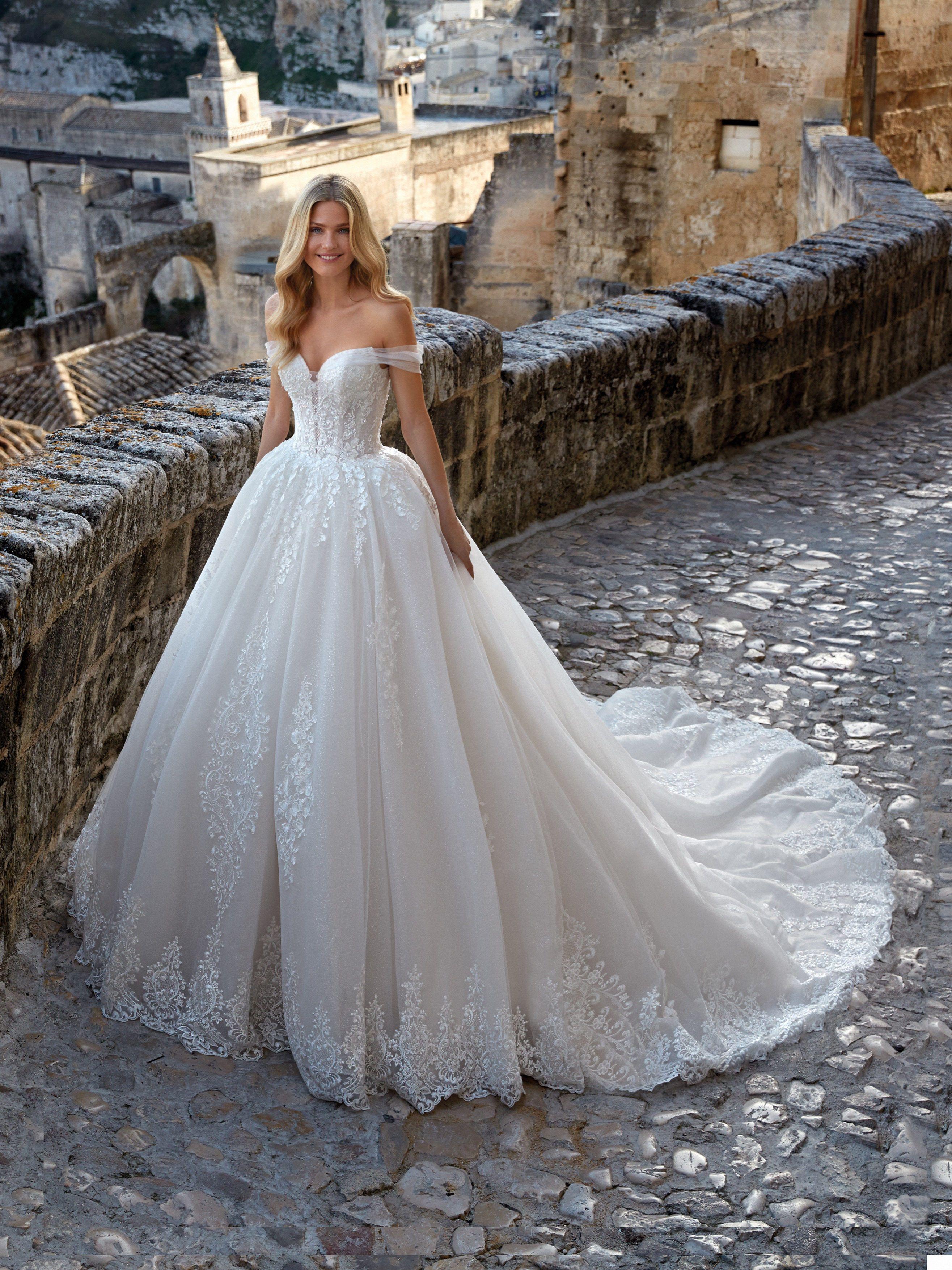 Princess wedding dress with off shoulder neckline and romantic ...