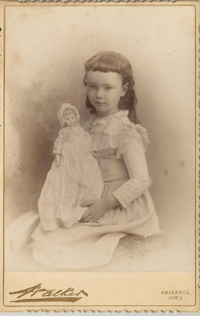 with a doll , 1890