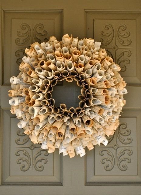 neato! paper wreath made from 500 pages of sheet music, hymnals, dictionary, or novel book pages. - very fragile and very cool