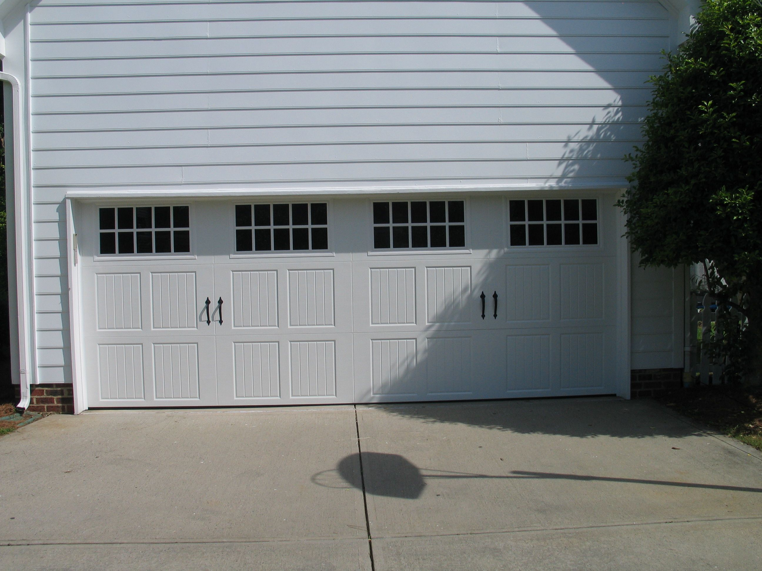 Three panel carriage house garage door with large windows three panel carriage house garage door with large windows rubansaba