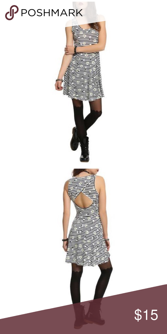 Black and White Stripe Skull and Daisy Dress Skulls and small Daisies on the print with an open back. Only flaw is around the waist, it looks like the material is separating because of the material it's made from, dress isn't ripped though! Hot Topic Dresses