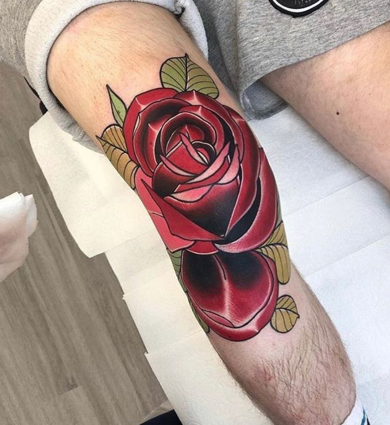 Realistic red rose tattoo on the knee done by