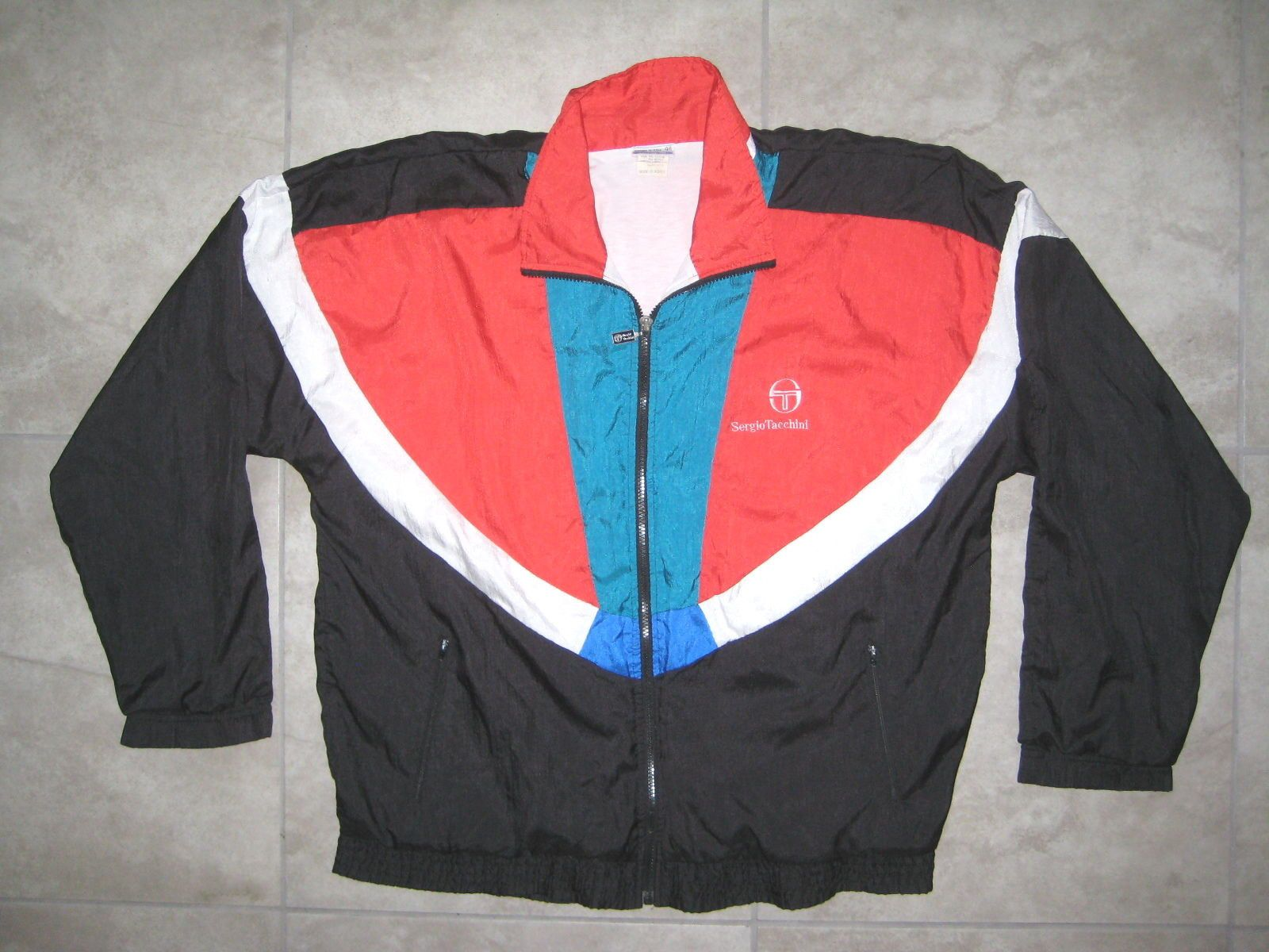 b4e86fb0c Colors: Red Black Blue White. Item is preowned and used but in great  overall condition. NO rips or tears or bad odors. Zipper is missing some  paint.
