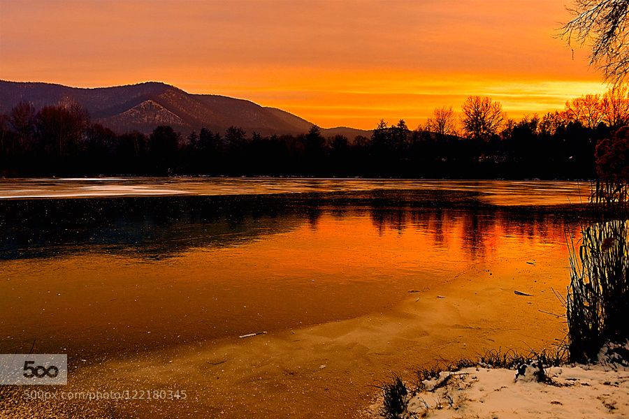 Ice and fire - Pinned by Mak Khalaf Fine Art coldfine articelightmountainsskysnowsunsetwaterwinter by citromos12