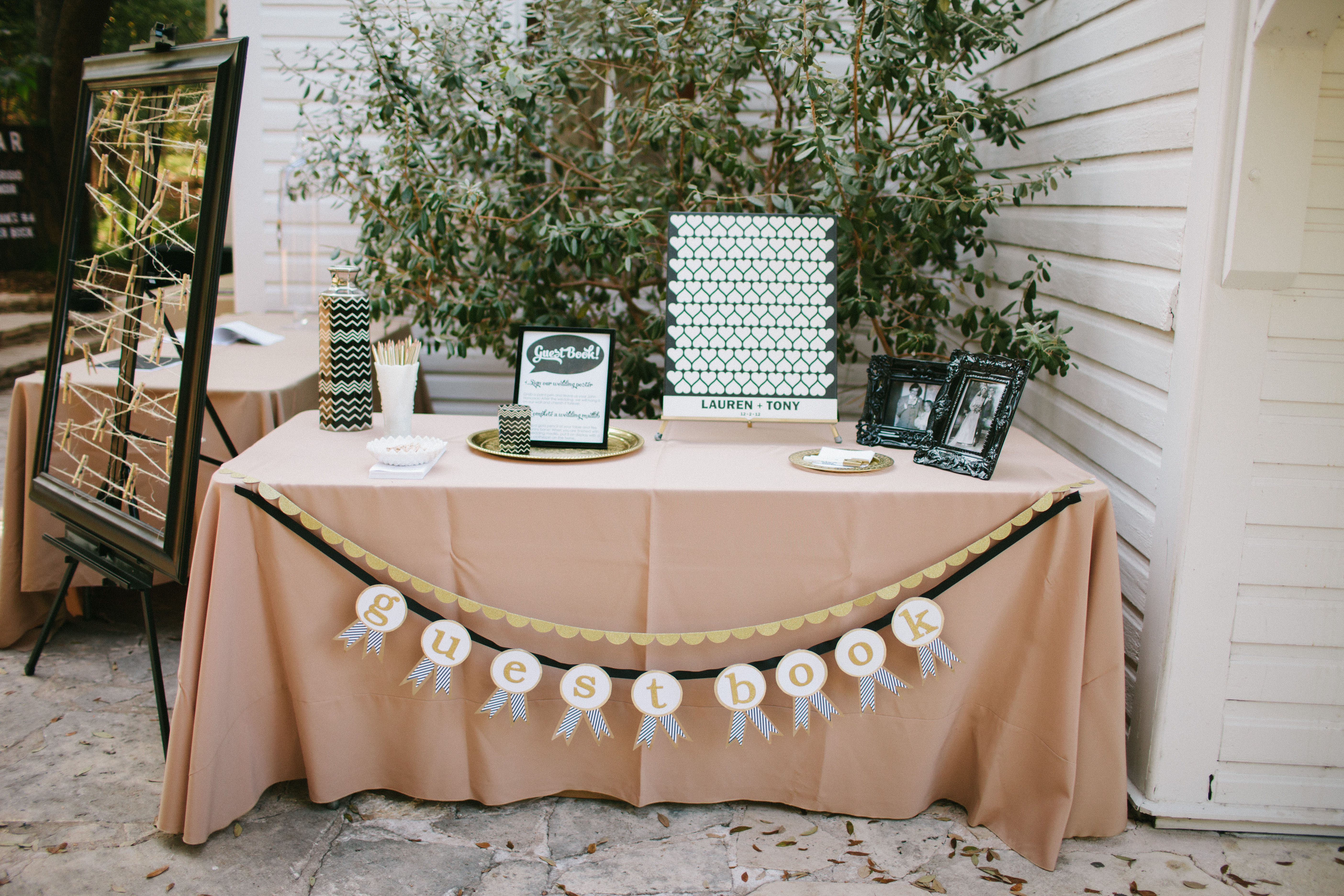 cute idea have a large frame with clothesline and have guests