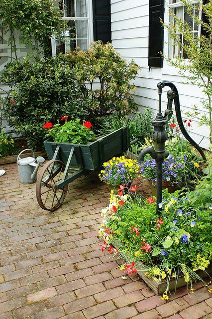 Wheelbarrow and old pump (1) by KarlGercens.com, via Flickr