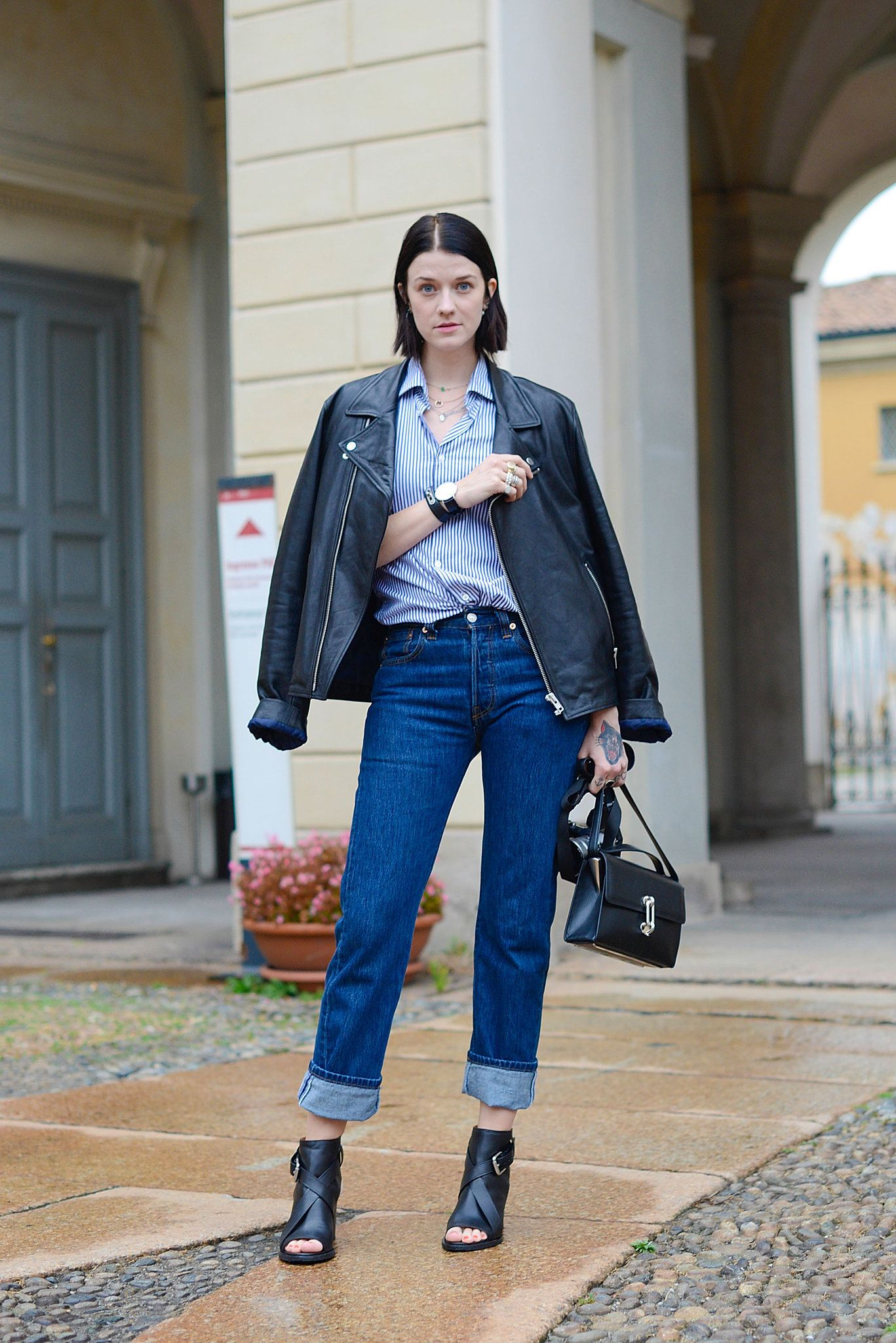 """Now's the time to get away with jeans at the office. Instead of channeling your inner teenager, make them feel 9-to-5 polished with a silky blouse and blazer. And don't forget your pumps or pointy flats for a look that says """"I can hang with the grown-ups — I'm just a lot more stylish."""""""