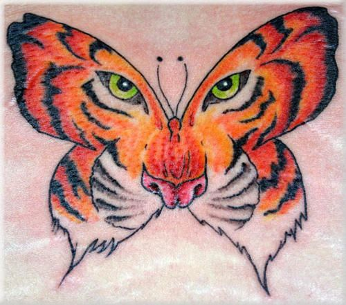 Butterfly with a tiger face tattoo http 99tattooideas for Tiger face in butterfly tattoo