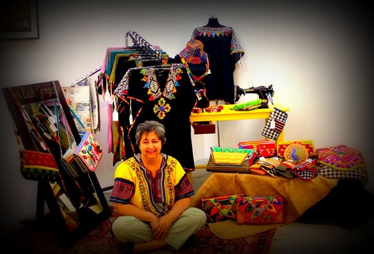 The designer, Minakshi Nagu, in her Pop-Up Shop. In the background, you can also see the first sewing machine she ever used.