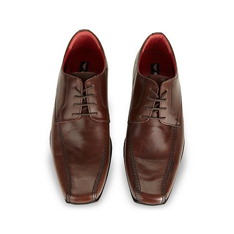 35. Red Tape Brown leather tramline