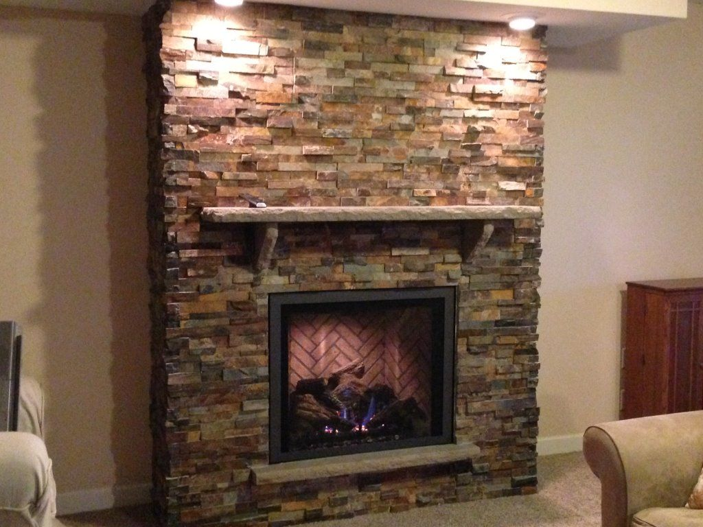 Mendota gas fireplace w/ Wide Grace Front in Vintage Iron and an Indiana  limestone mantel and California Gold Ledgestone installed in Lake Elmo, MN.