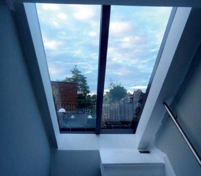 Bespoke Sliding Over Fixed Rooflight For Sloped Roofs London Roof Light Roof Architecture Patio Roof