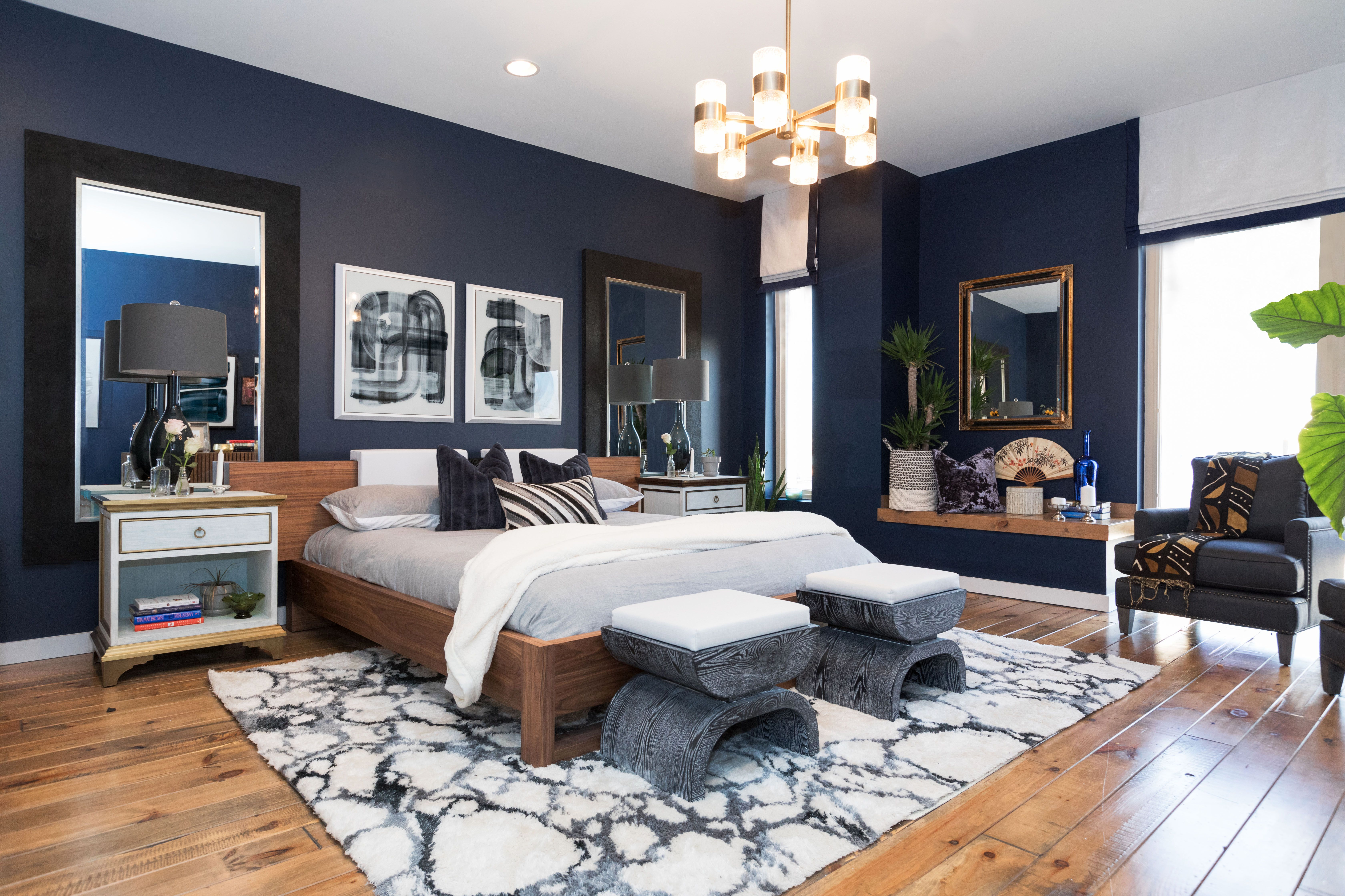 This Master Bedroom Has Modern Art A Dark Wall Color A Shag Rug And Gold Accents To Cre Blue Master Bedroom Master Bedroom Colors Bedroom Paint Colors Master