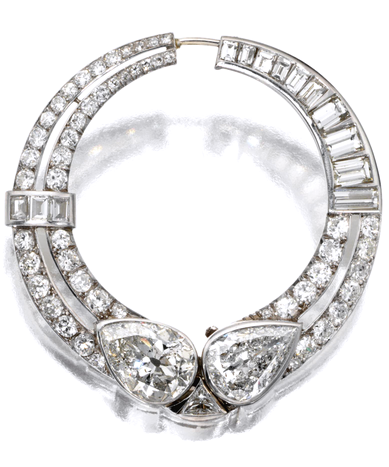 ART DECO DIAMOND CIRCLE BROOCH, CIRCA 1925  The hinged circle set at the base with 2  pear-shaped diamonds weighing approximately 5.20 and 3.50 carats respectively, flanking a triangular-shaped diamond, completed by 51 round and single-cut and 13 baguette diamonds weighing approximately 4.00 carats, mounted in platinum, French assay marks.