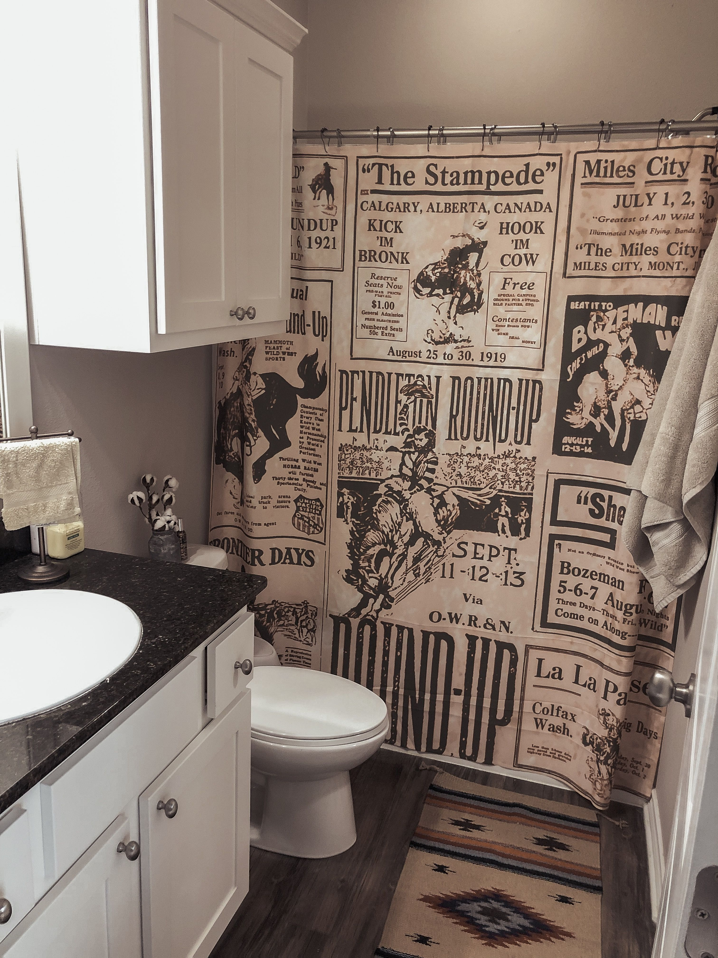 Old Rodeo Poster Shower Curtain With A Navajo Rug And A Little