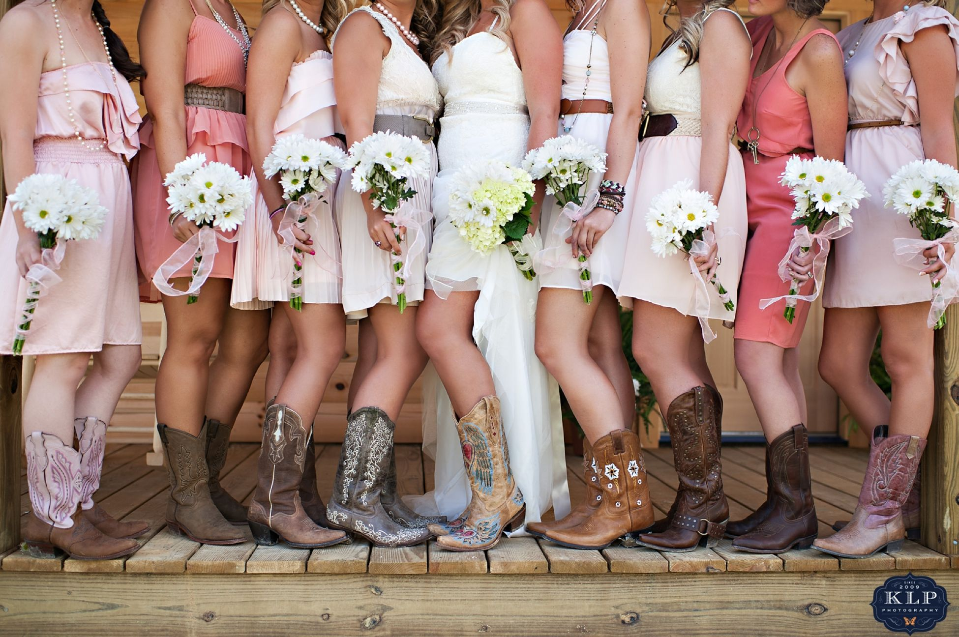 country themed wedding dresses These bridesmaids rocked the cowgirl boots and short pink dresses Love the cowgirl boots Country Themed Wedding