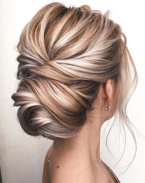 100 Elegant Wedding Ideas To Wow Your Guests Low Bun Updo Hairstyle For Modern Weddings Beautiful Wedding Hair Bride Hairstyles Blonde Updo