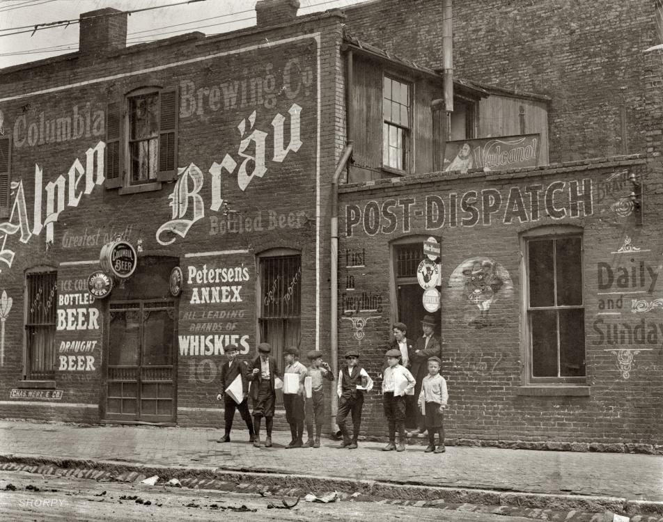 "St. Louis, Missouri. May 1910. ""Newsies. Johnston's Branch adjoining Saloon at 10th & Cass Street."" L. Hine"