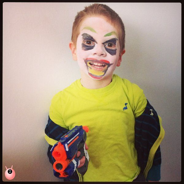 Home made fun with Superheroes villains - The Joker from Batman with face paint and a gun