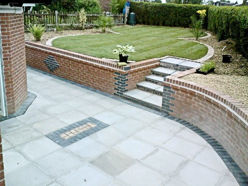 Slabs with steps to lawn garden ideas pinterest lawn for Garden patio slab designs