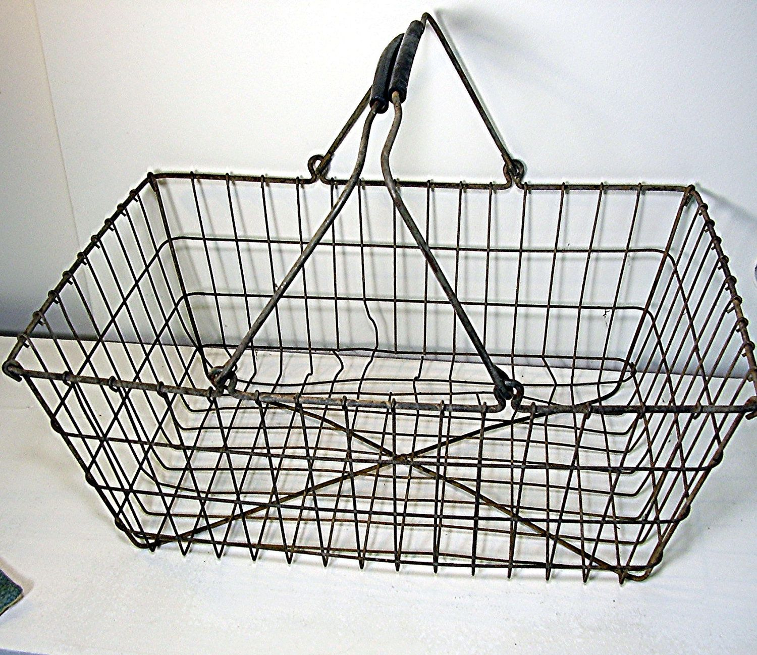 Vintage basket. I love these old wire baskets & wiry chairs too ...