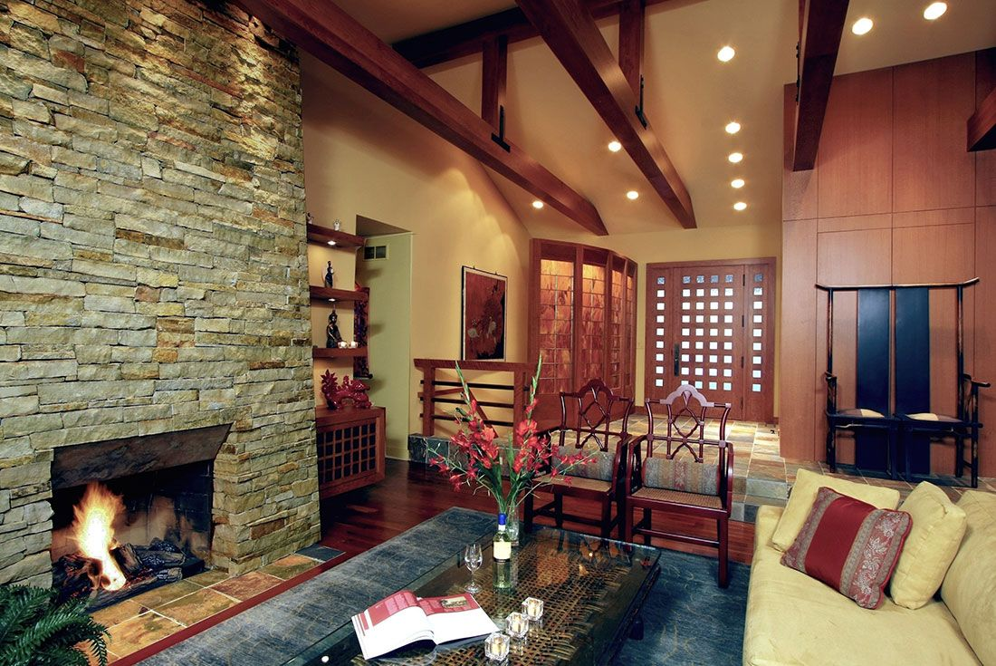 The living room for a home that's a blend of Asian style and lodges of the Mojave dessert. Beams were added to this renovated space to bring the high ceilings down to a more personal level. | to see more of the project, visit studioduo.net