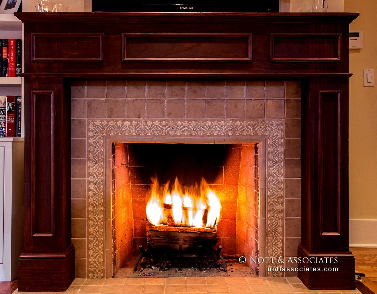 New wood burning fireplace with custom tile and woodwork