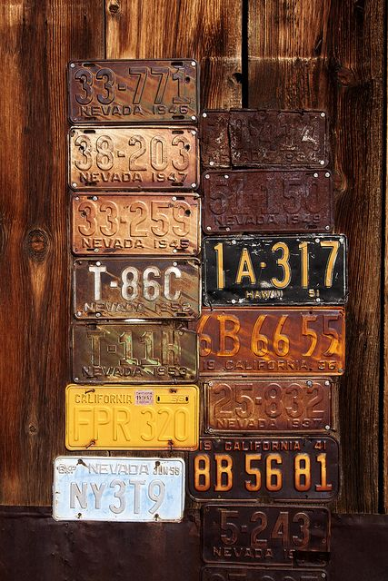 old rusty license plates on barn wood