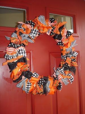 Ribbon wreath; can use bows or knots on a hanger, cheaper than foam