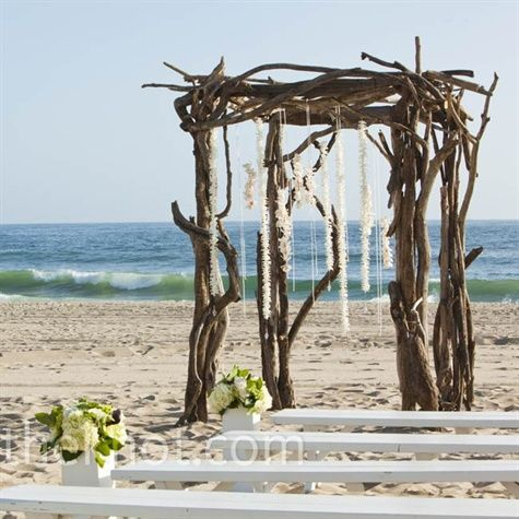 For a rustic twist on their beach setting morgan and brett for a rustic twist on their beach setting morgan and brett exchanged vows beneath a driftwood arch decorated with strands of hanging white orchids junglespirit Image collections