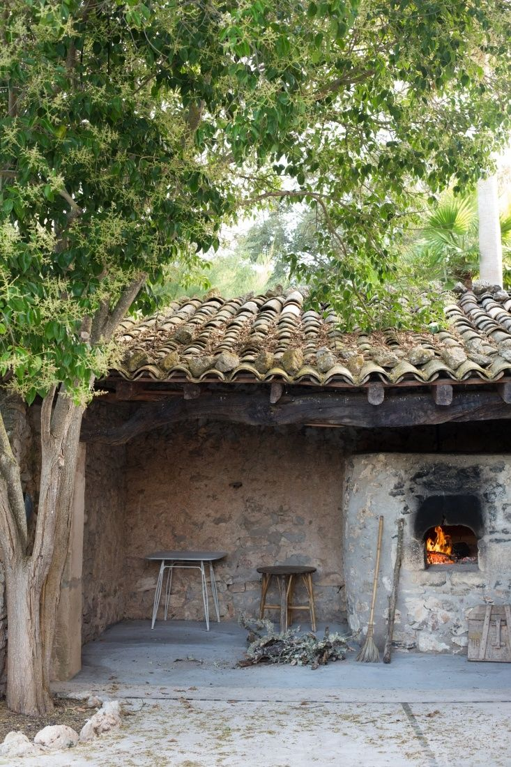 Mallorcal house with an outdoor kitchen fireplace
