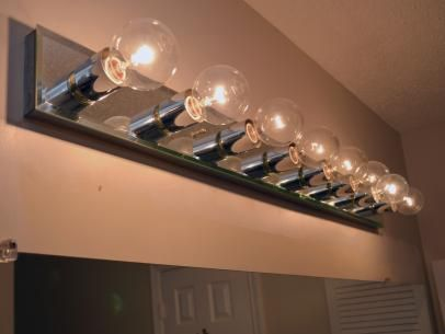 Is A Dated Bathroom Light Fixture Making You Look Bad See How Easy It To Install New Lighting Over Your Mirror