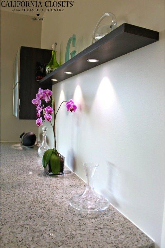 Floating Shelf With Recessed Under Cabinet Lighting Illuminating A Quartz Countertop Interiordesign