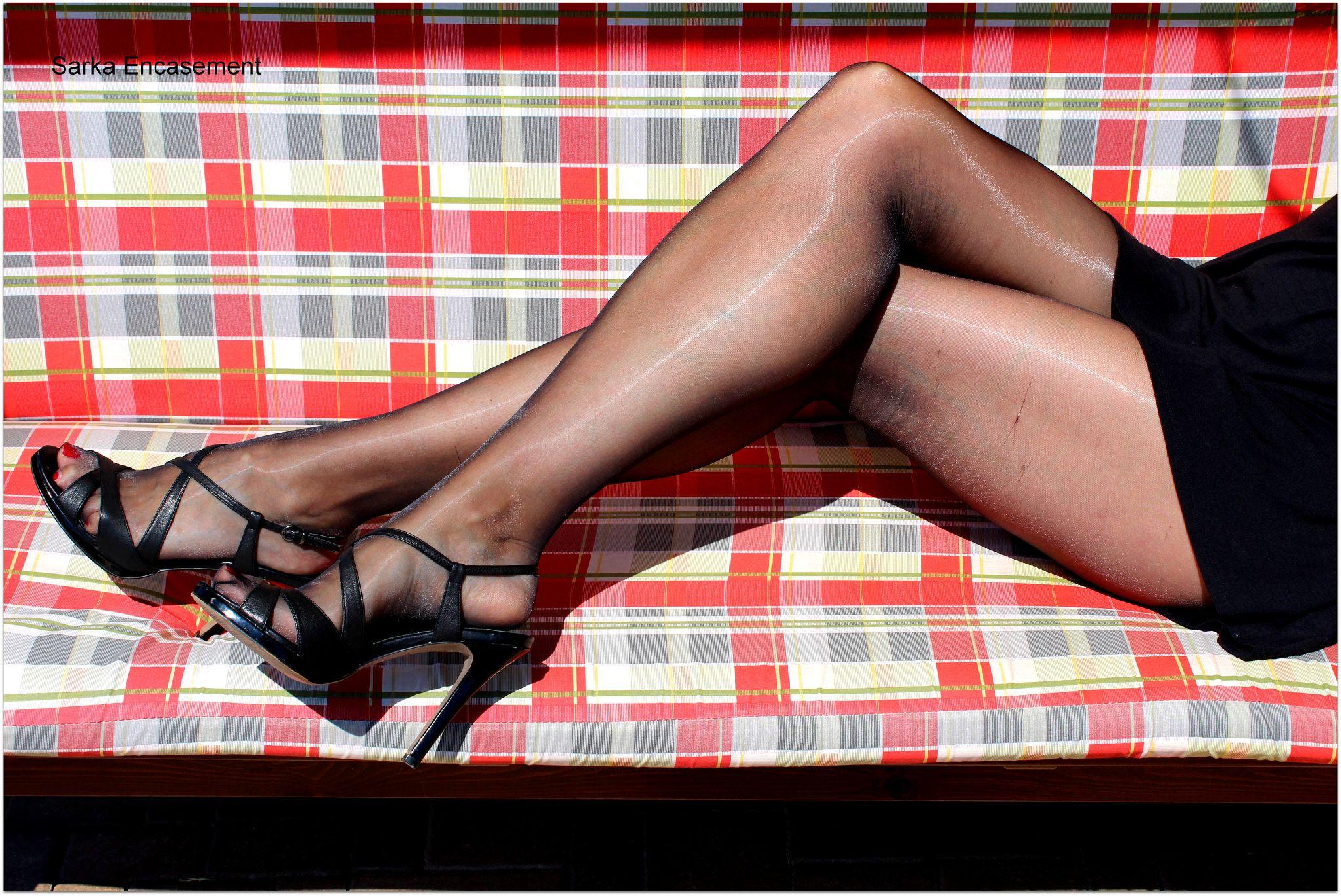 Beine Strümpfe und Absätze