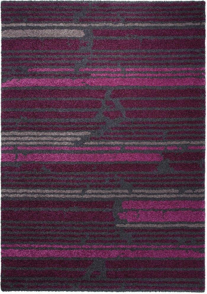 Ein extravagantes Streifenmuster, das mit einem Strukturdesign durchbrochen wird. Die in unterschiedlichen Helligkeiten eingearbeiteten Magenta-und Anthrazittöne verbinden sich zu einem feinen Farbkontrast. Ein außergewöhnlicher Designerteppich.