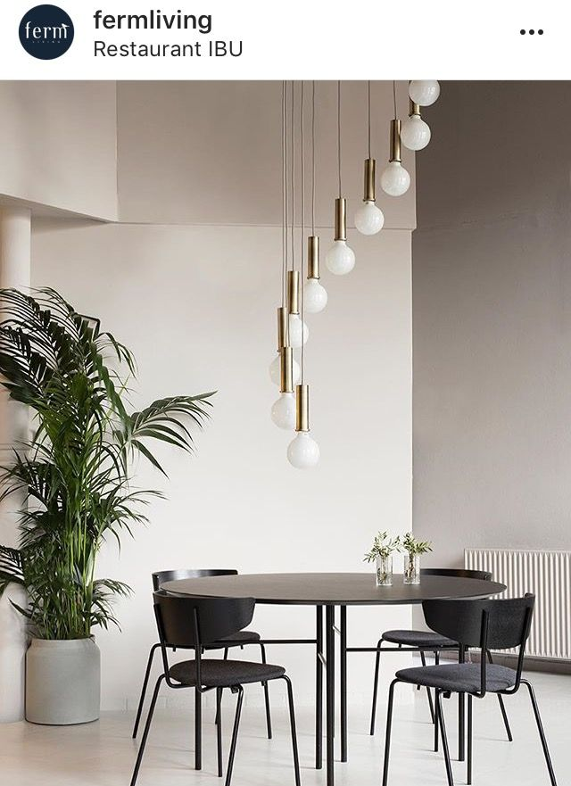Minimalistic dining area with breathtaking lamp The