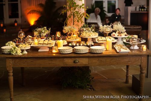 Using cake plates to create levels party tables for Mobilia wedding