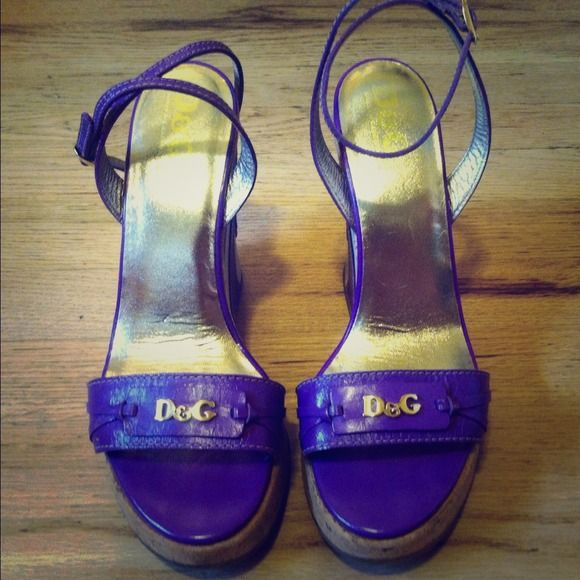 """Dolce & Gabbana wedges 100% authentic D&G purple wedges made in Italy. Super fun wedges with heart on back of heel with D&G stamped into the leather. Kept stored in container at all times. Only worn 3 times and in perfect condition. Great additional to your summer wardrobe ! Heel 5"""", 1 1/2"""" platform. Dolce & Gabbana Shoes"""