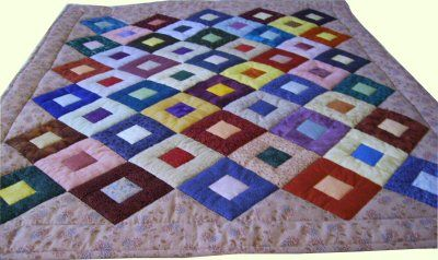 Cobblestones Charity Quilt Tutorial http://www.victorianaquiltdesigns.com/VictorianaQuilters/CharityQuilt/CobblestonesCharityQuilt.htm #quilting #charity