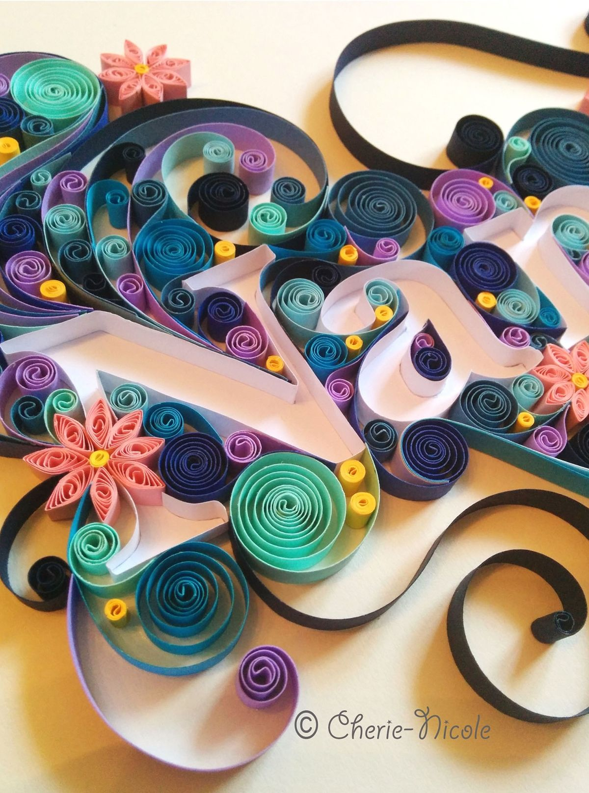 A personalised quilling piece. Wanted to try a different style; quilling around letters rather than within them.