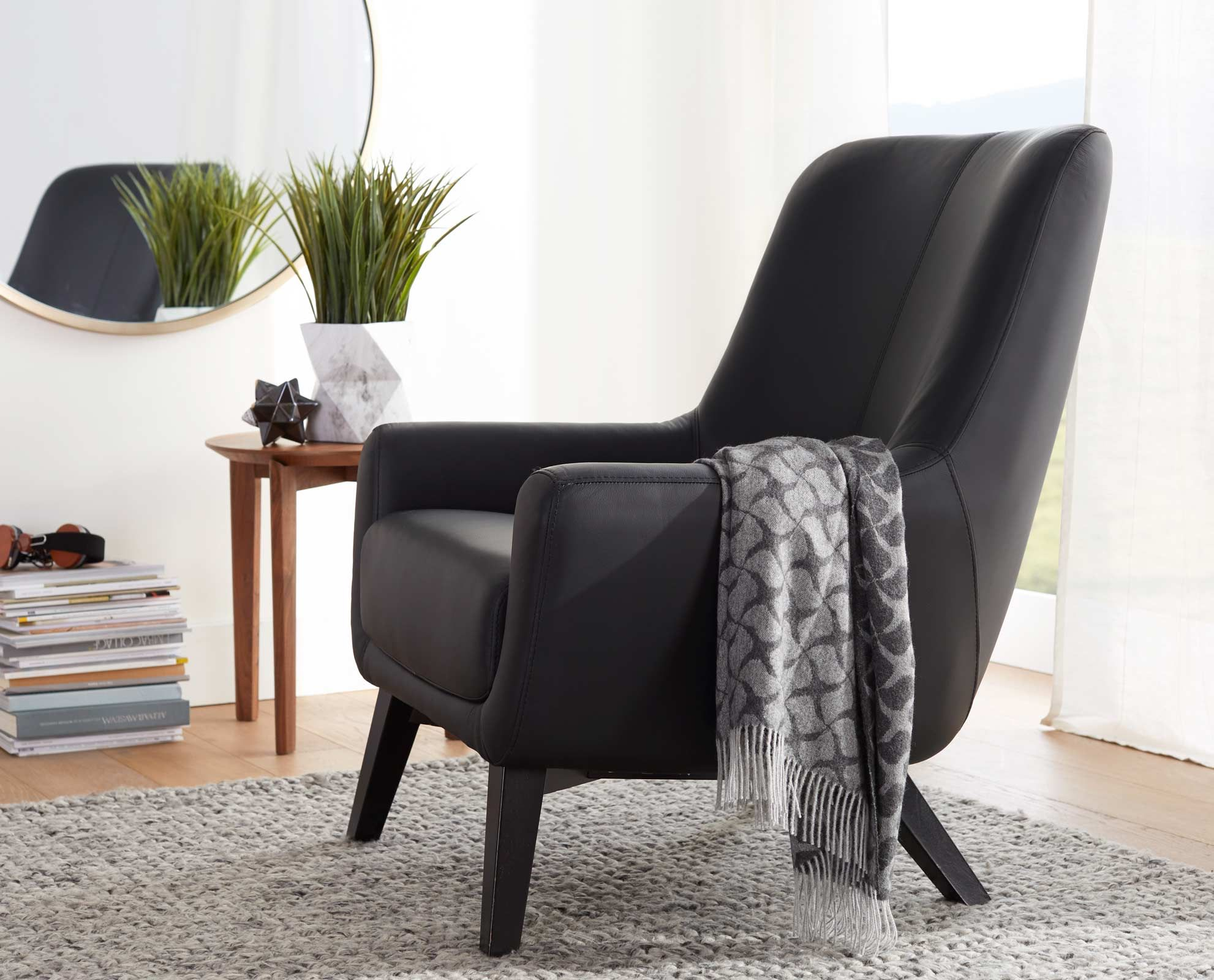 Scandinavian Designs Upholstered In Black Leather With Distinctive Stitching The Gisella Chair Ble Red Leather Chair Leather Wingback Chair Unique Furniture